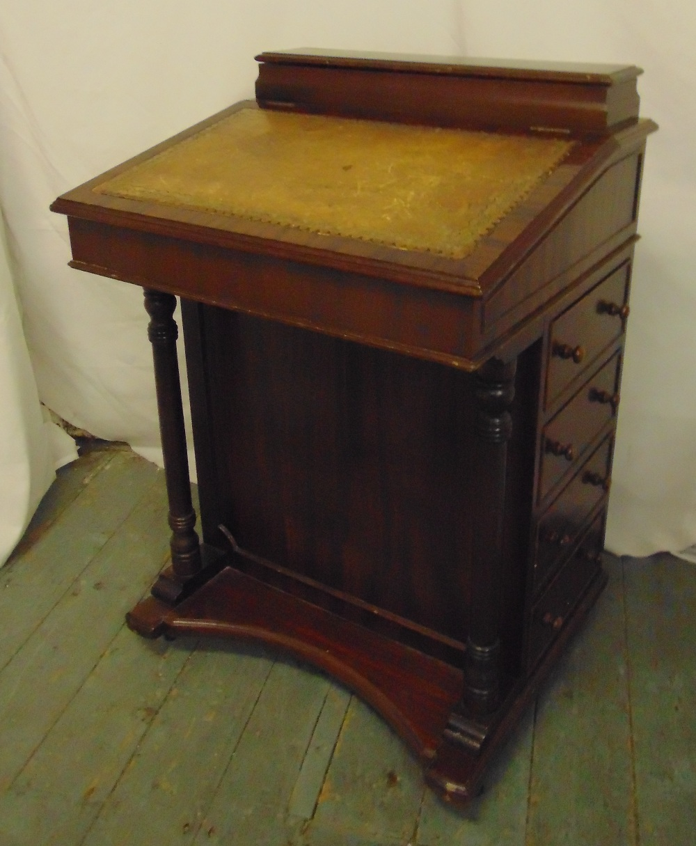 Lot 2 - A rectangular mahogany Davenport with tooled leather top and four drawers on shaped rectangular