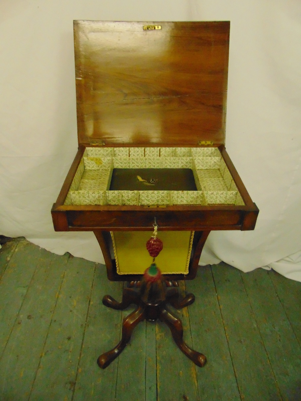 Lot 36 - A Victorian rectangular sewing table with single drawer on four scroll legs