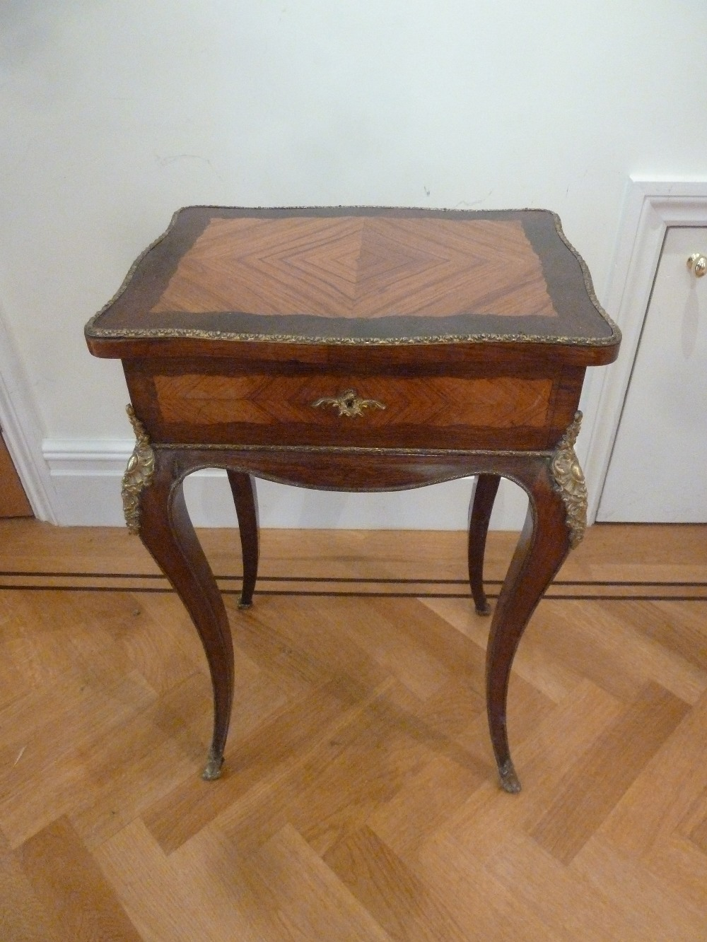 Lot 11 - A French Louis XVI style rectangular side table with hinged top on cabriole legs