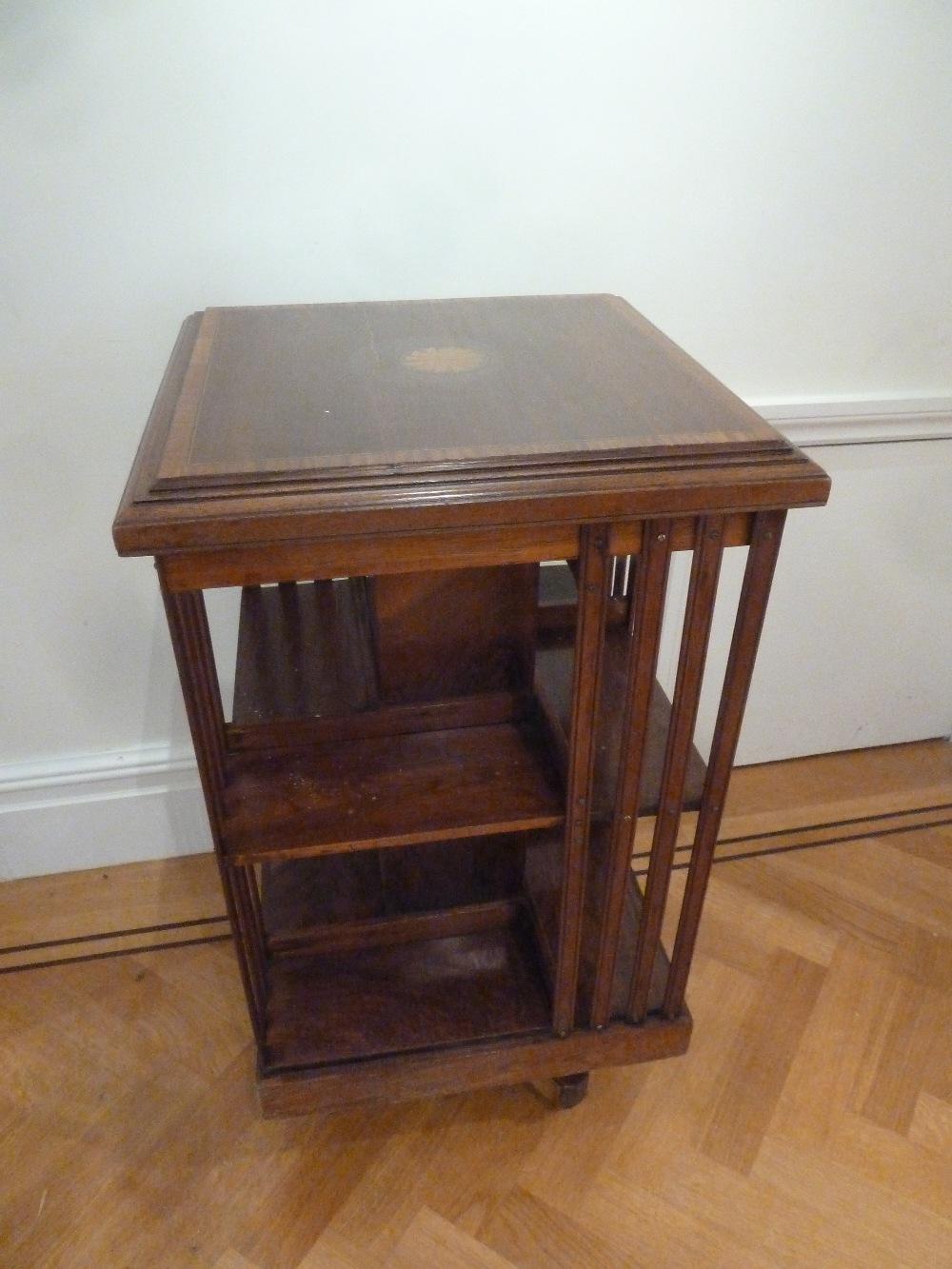 Lot 23 - An Edwardian mahogany inlaid revolving rectangular book stand