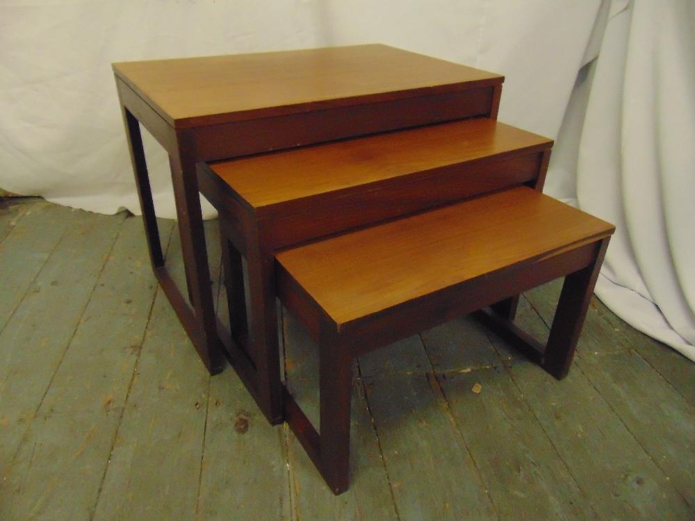 Lot 35 - A nest of three rectangular teak side tables