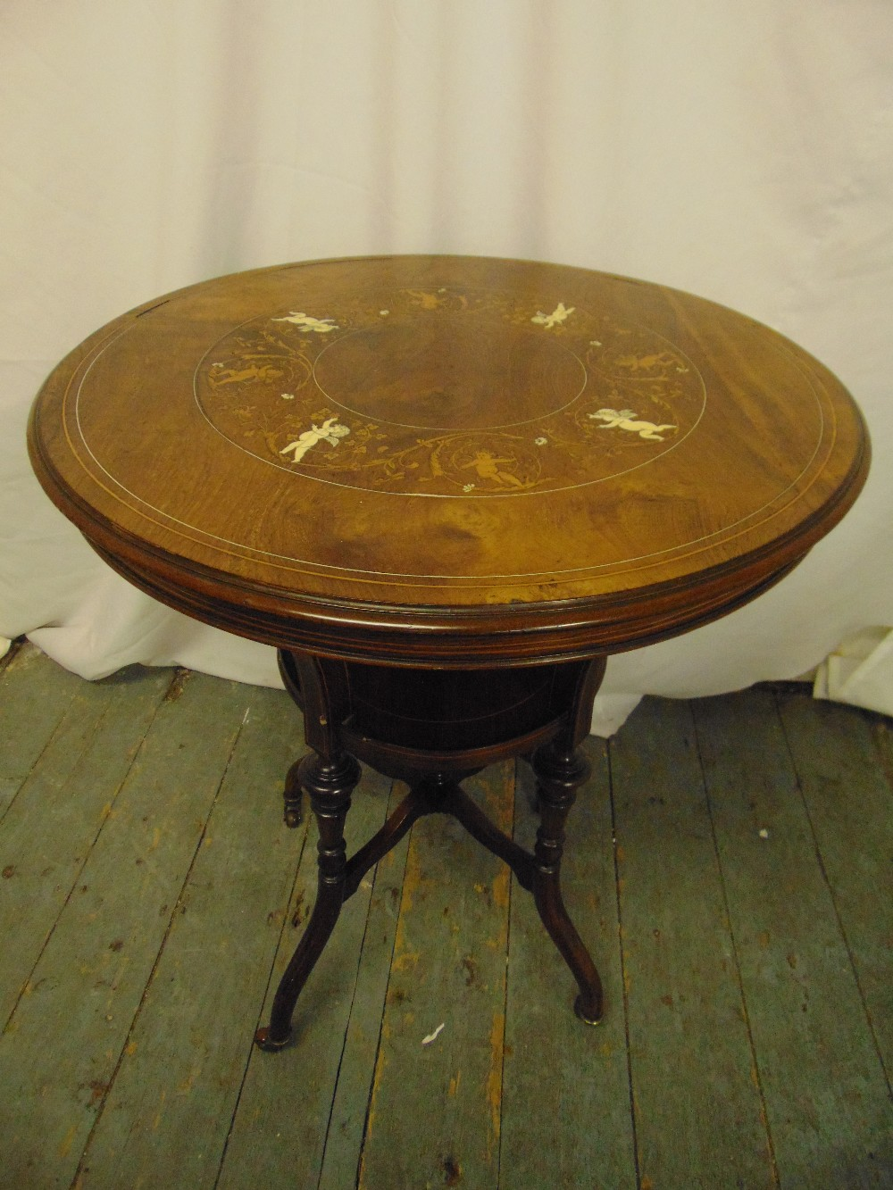 Lot 10 - An Edwardian circular occasional table inlaid with satinwood and bone, on cabriole legs