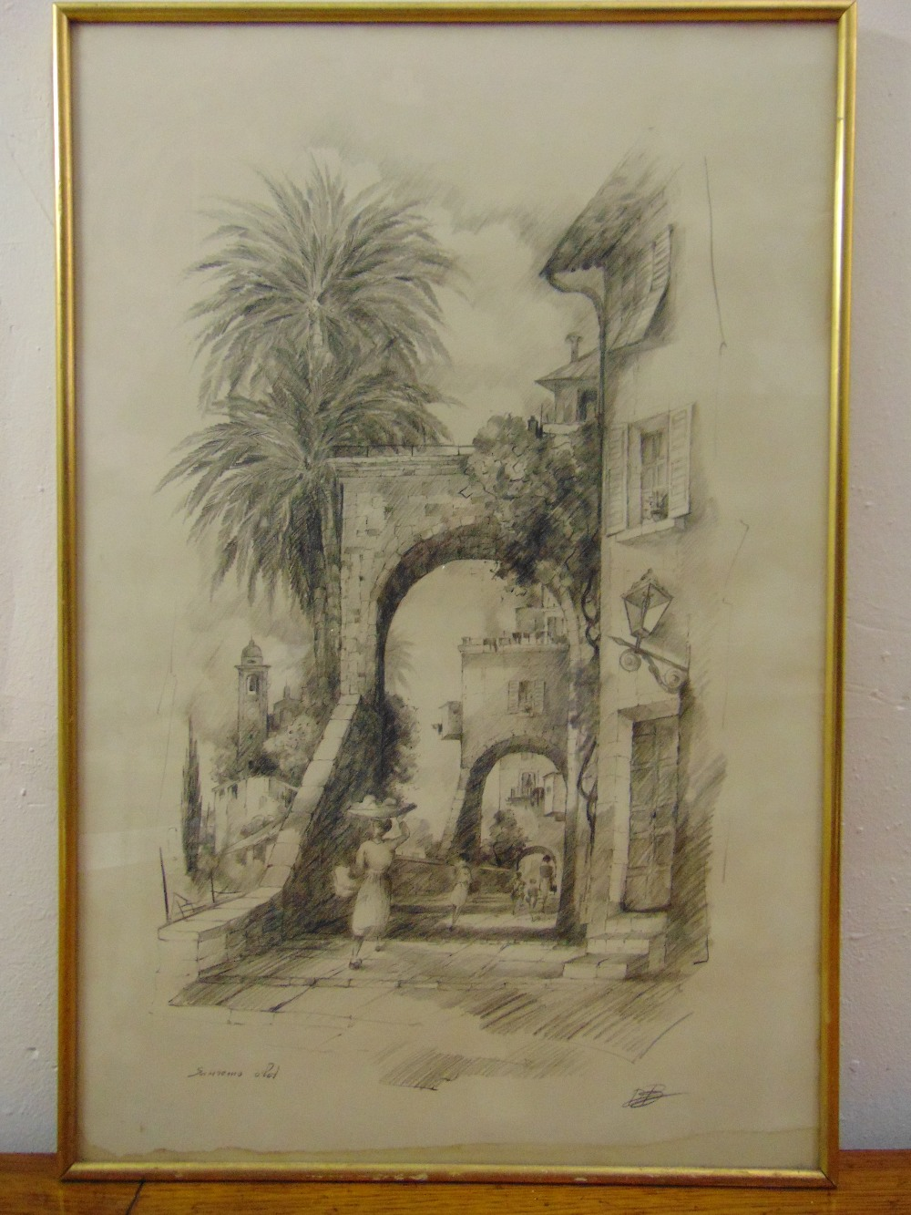 Lot 37 - A framed and glazed pencil drawing of San Remo indistinctly signed bottom right, 63 x 38cm