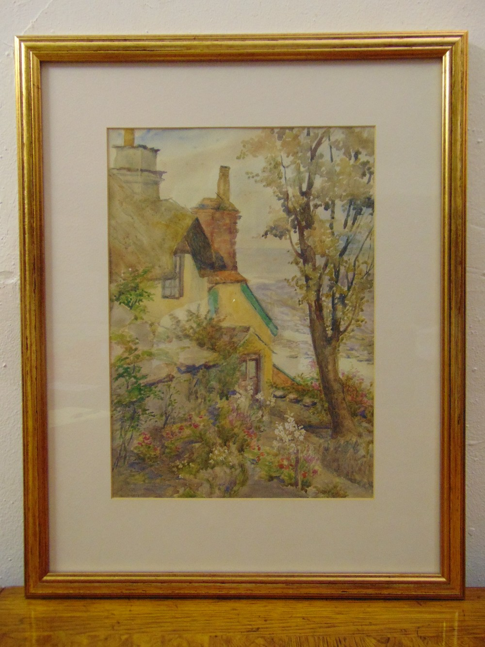 Lot 42 - Agnes E. Ferman 1910-1939 framed and glazed watercolour of a country cottage, 34.5 x 24.5cm