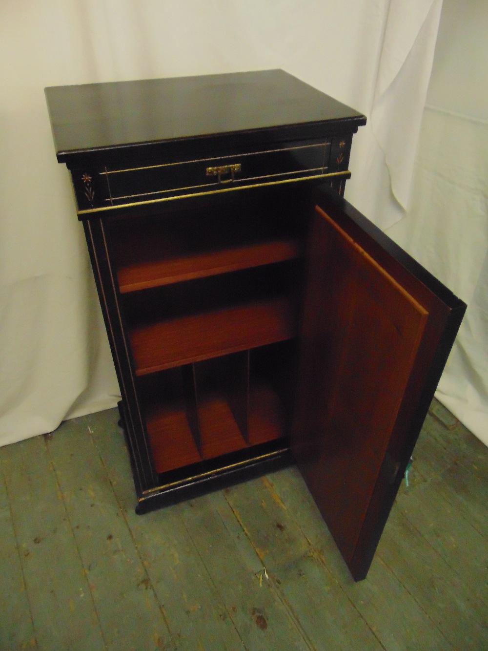 Lot 5 - An Edwardian rectangular ebonised inlaid mahogany music cabinet with bevelled mirror to hinged