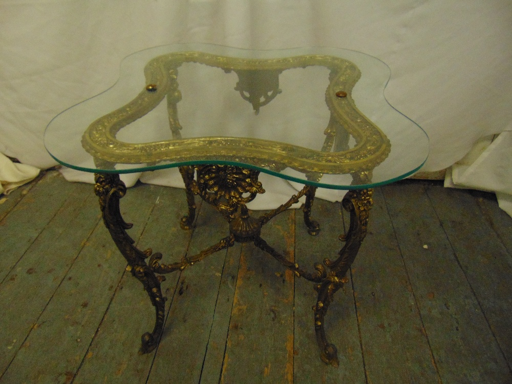 Lot 12 - A rectangular gilt metal side table with glass top on four scroll legs