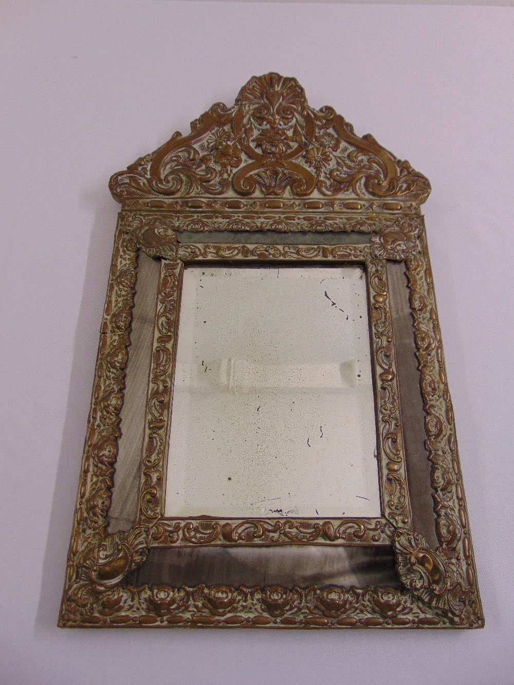 Lot 20 - A 19th century continental brass wall mirror with five mirrored panels