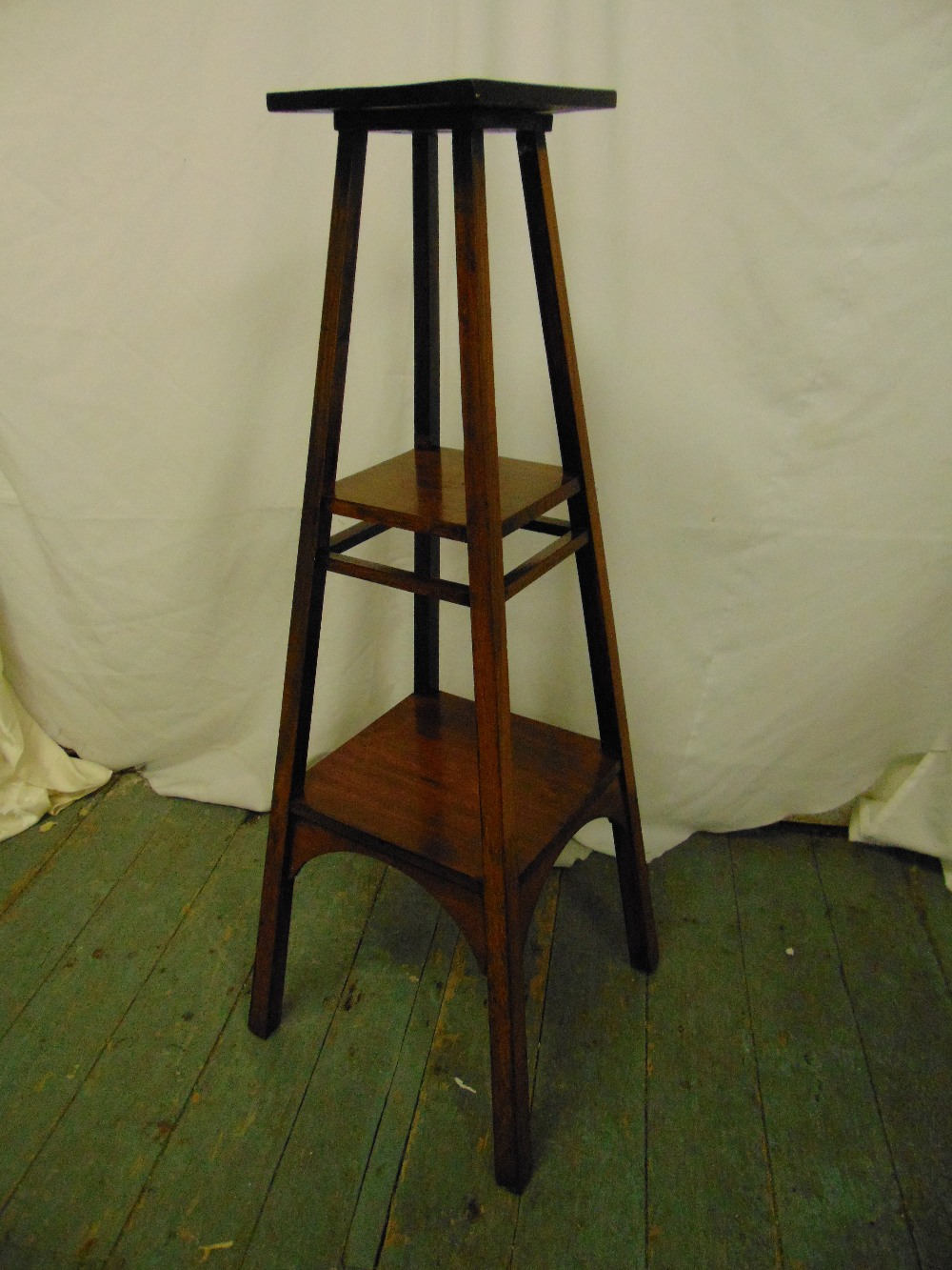 Lot 14 - A mahogany arts and crafts plant stand, the square sections with rectangular supports
