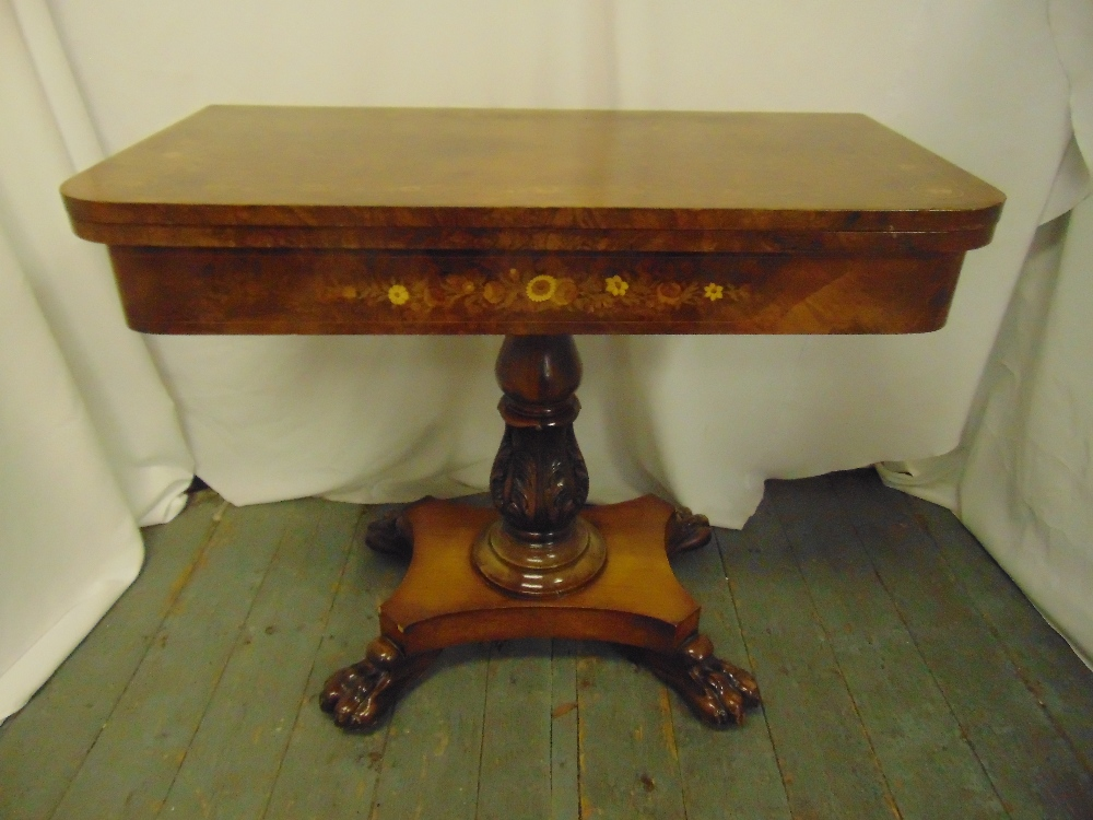 Lot 3 - A late Victorian rectangular walnut and mahogany games table on quatrefoil base with claw feet