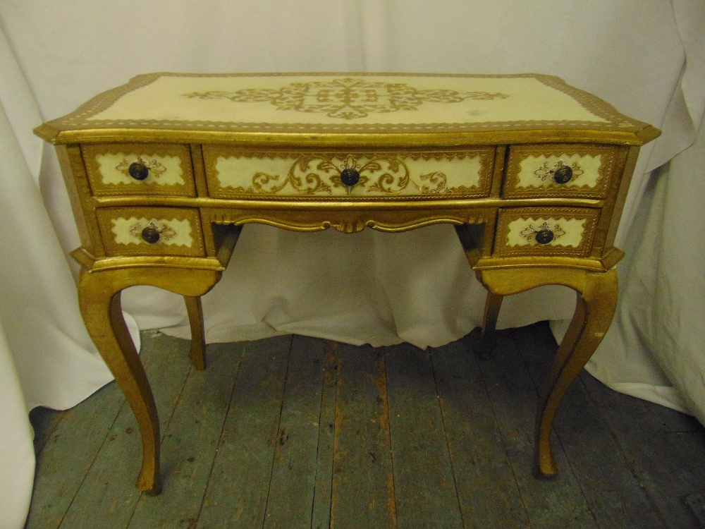 Lot 5 - A Florentine dressing table of rectangular form with five drawers and cabriole legs