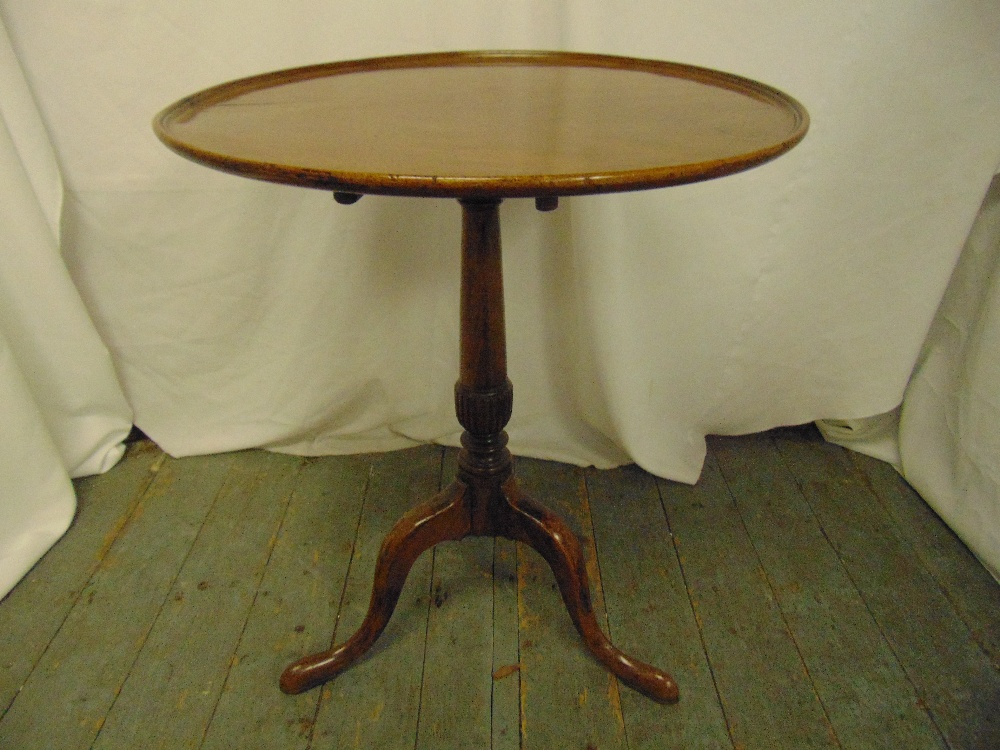Lot 21 - A Victorian mahogany circular tilt top occasional table on three outswept legs