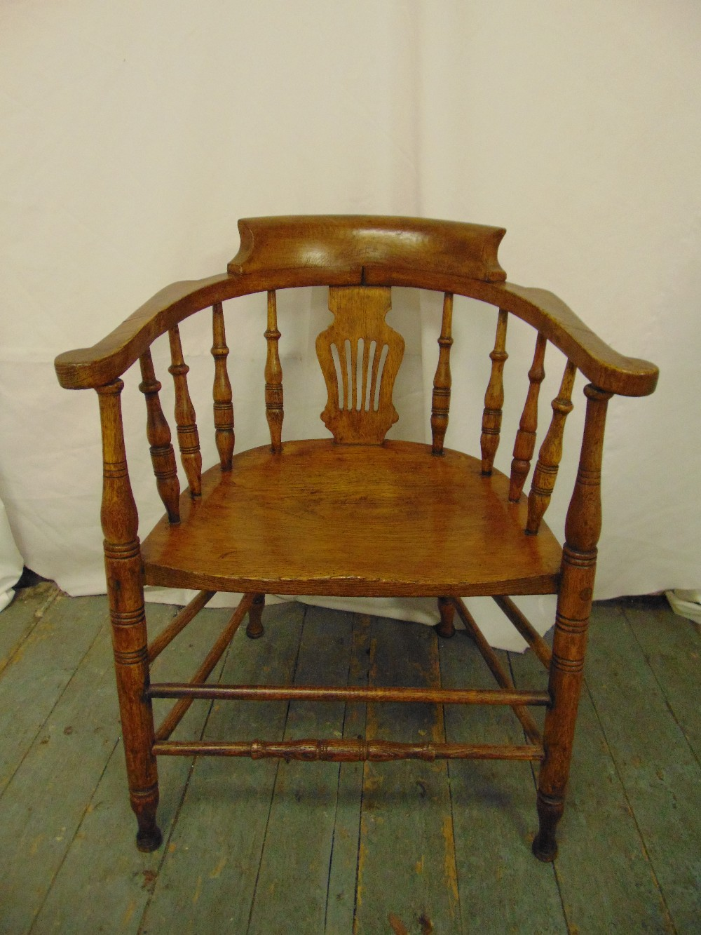 Lot 30 - A Victorian blonde oak occasional chair with turned spindles, scrolling arms on turned cylindrical