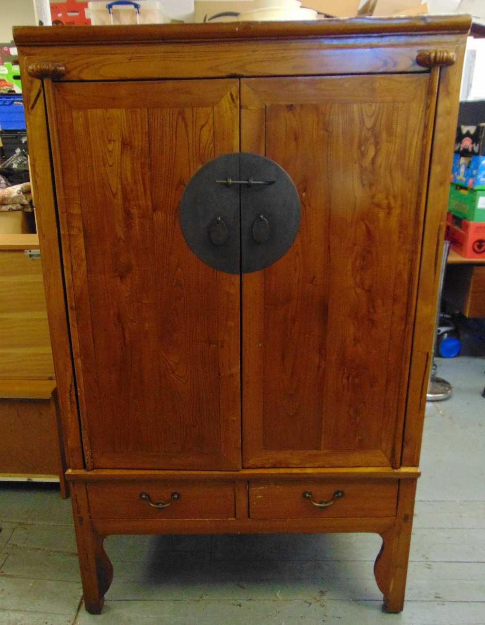 Lot 12 - An oriental rectangular hardwood cabinet, the hinged doors with circular brass lock plate above