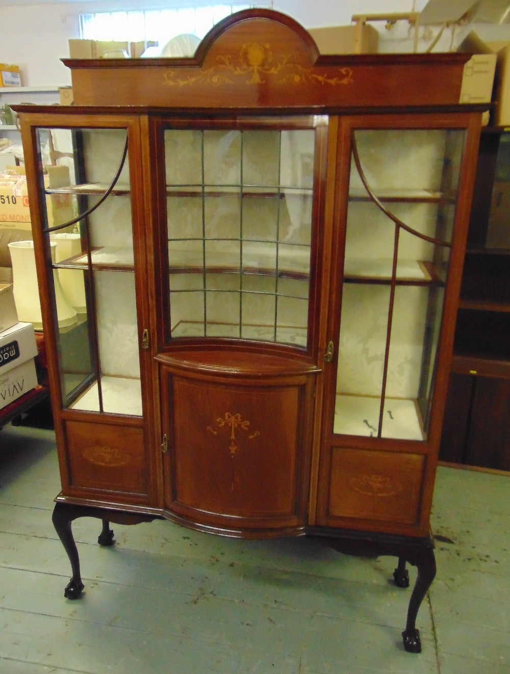 Lot 11 - An Edwardian shaped rectangular inlaid mahogany glazed display cabinet on four cabriole legs