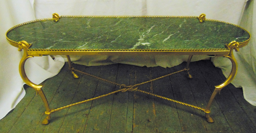 Lot 28 - A gilt metal and green marble shaped oval coffee table on four scroll legs