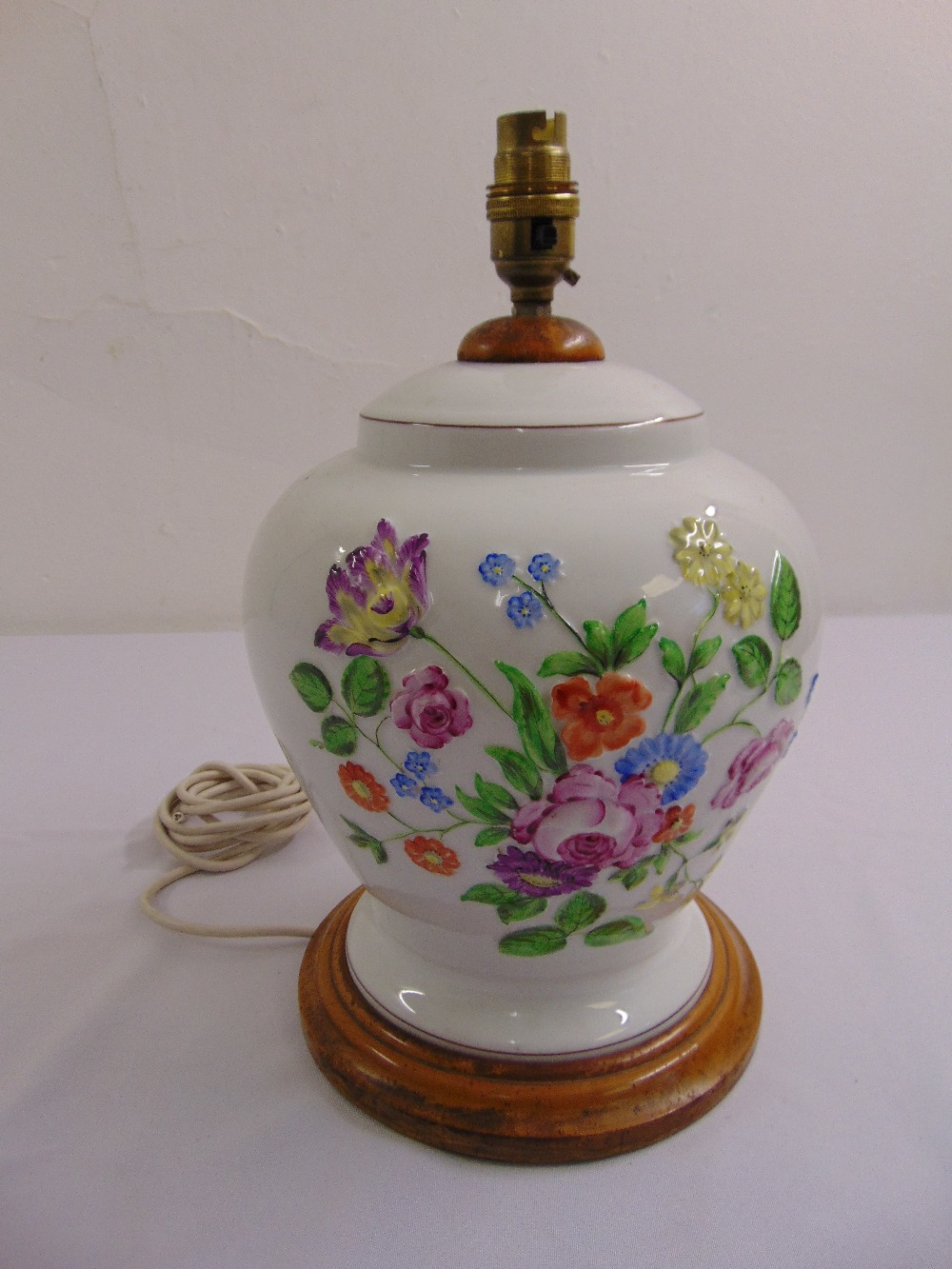 Lot 41 - A Herend baluster form porcelain lamp base decorated with flowers and leaves on turned wooden base