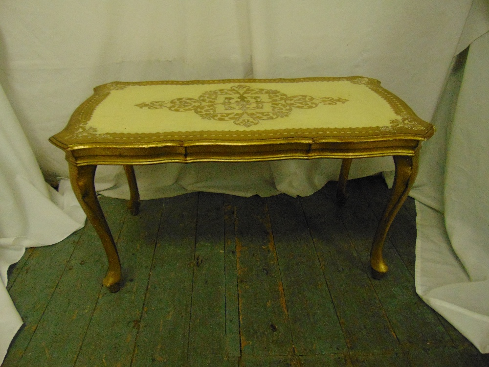 Lot 7 - A Florentine shaped rectangular coffee table on four cabriole legs