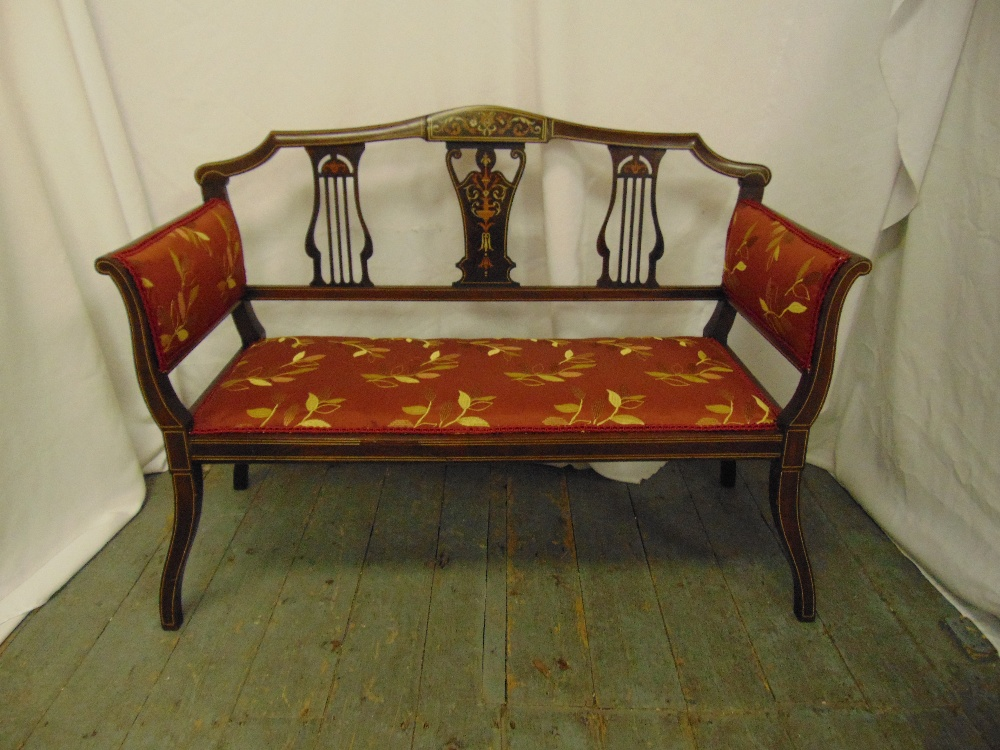 Lot 29 - An Edwardian two seater settle with upholstered seat and arms, pierced slat inlaid back on four