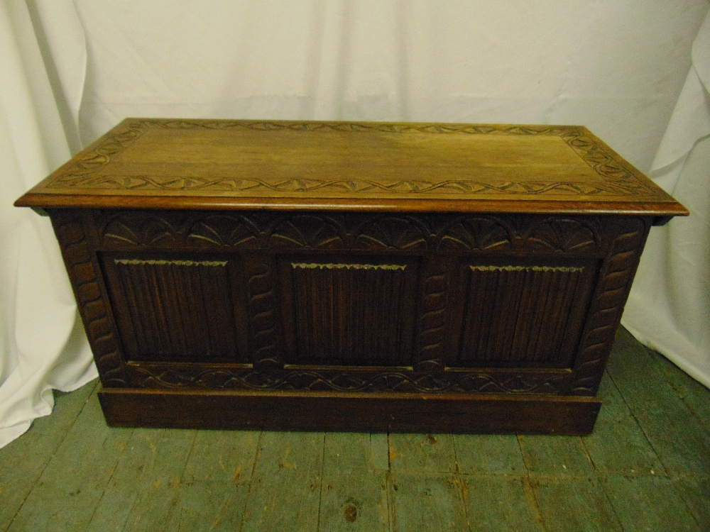 Lot 26 - A 19th century rectangular oak chest with carved sides and hinged cover