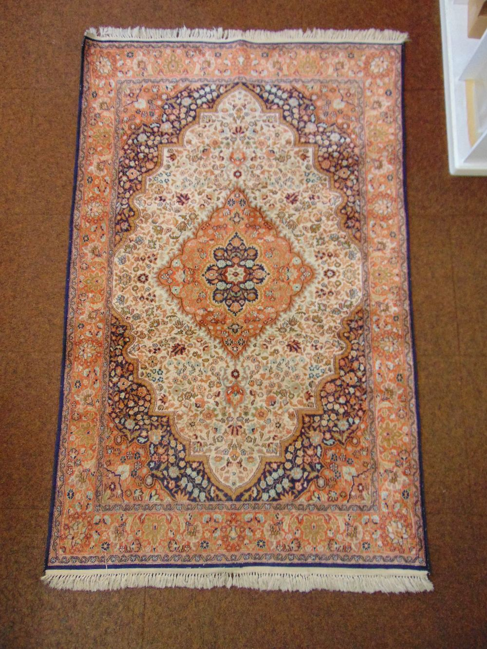 Lot 46 - A Persian wool carpet, red and blue ground central medallion within organic and stylised geometric