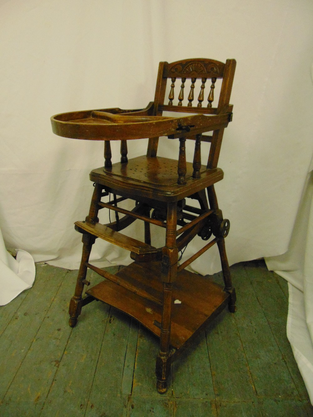 Lot 36 - An Edwardian oak metamorphic high chair on four turned cylindrical supports