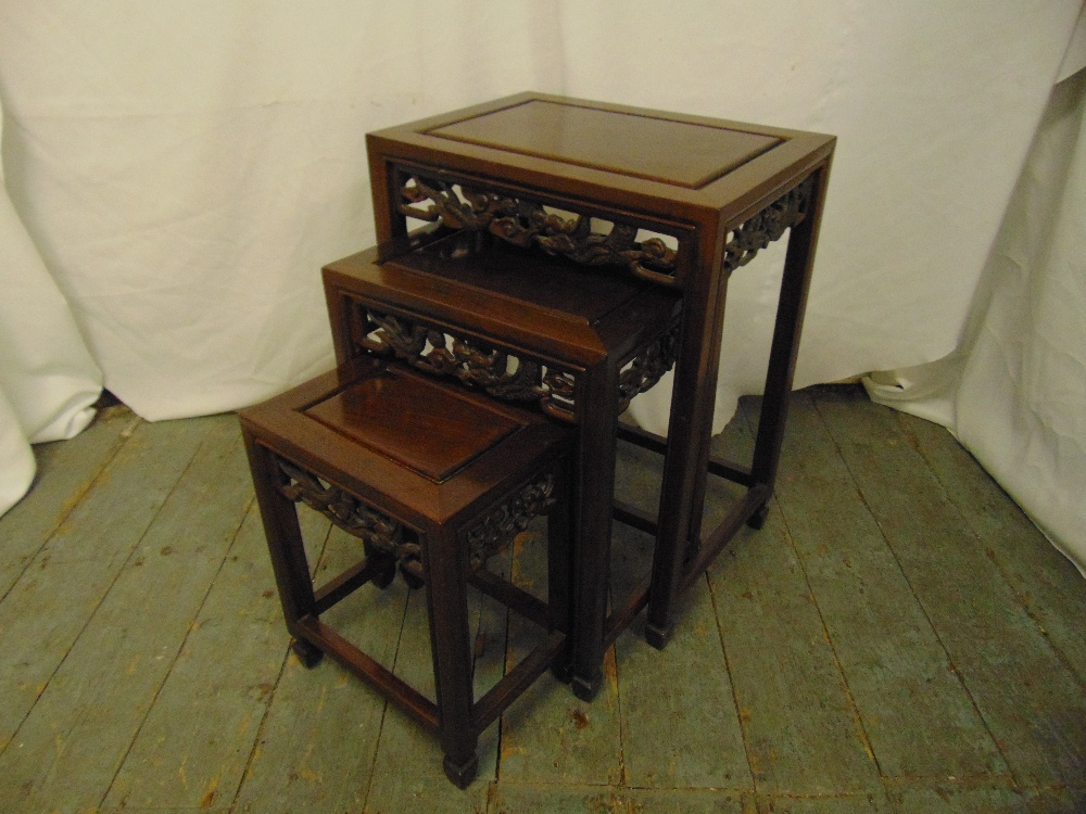 Lot 14 - A Chinese nest of three rectangular hardwood tables