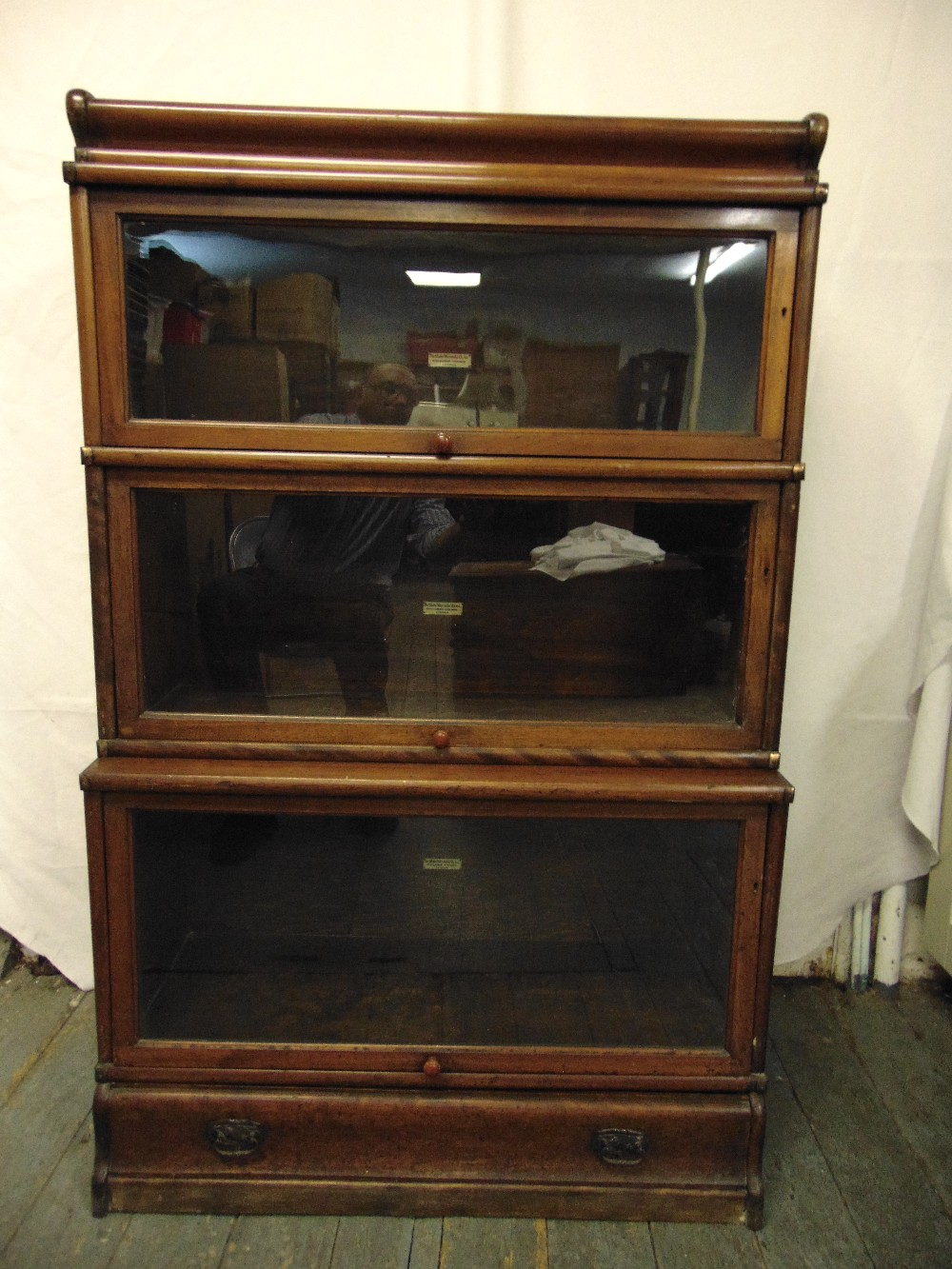Lot 1 - Globe Wernicke three section glazed bookcase with single base drawer section and top plinth