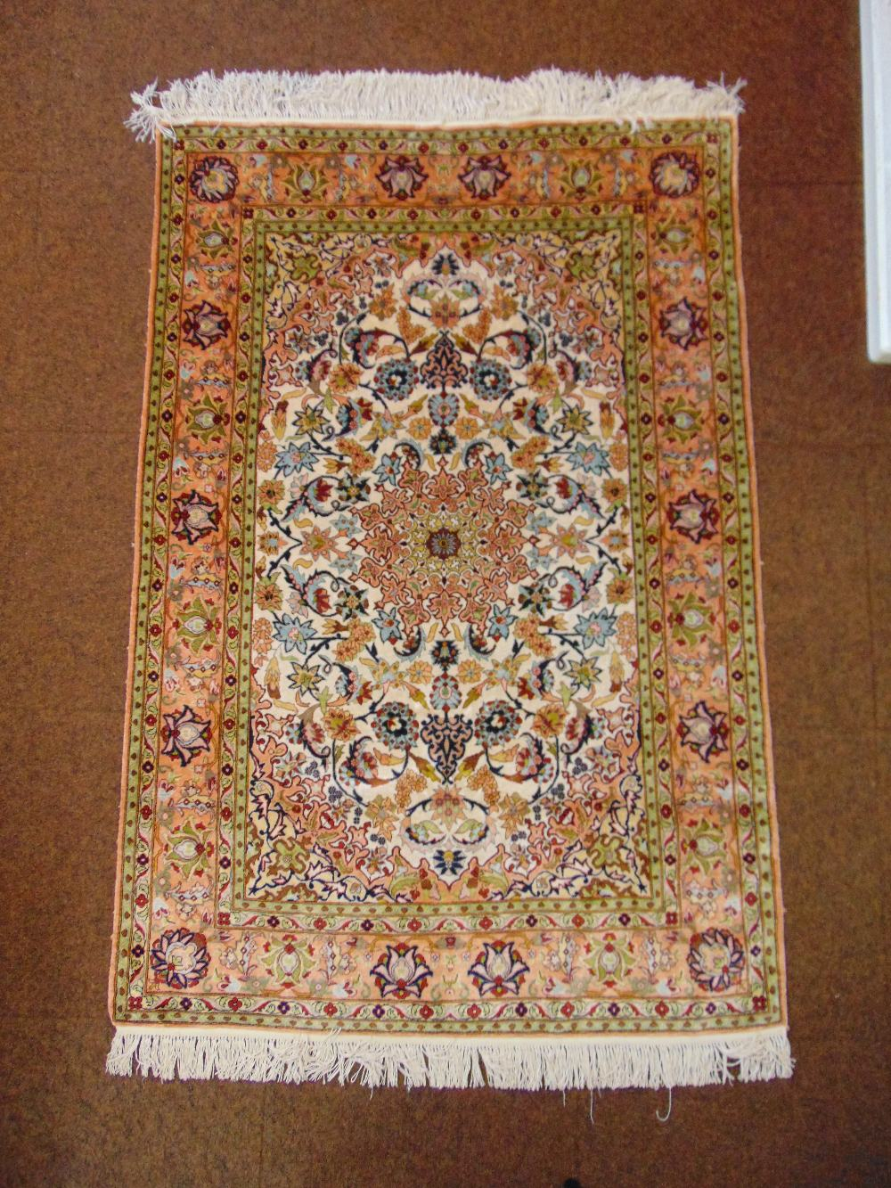 Lot 45 - A Persian silk and wool carpet, brown green and blue with stylised natural and geometric forms