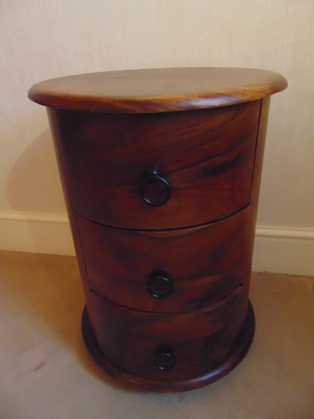 Lot 17 - A cylindrical mahogany three drawer side table