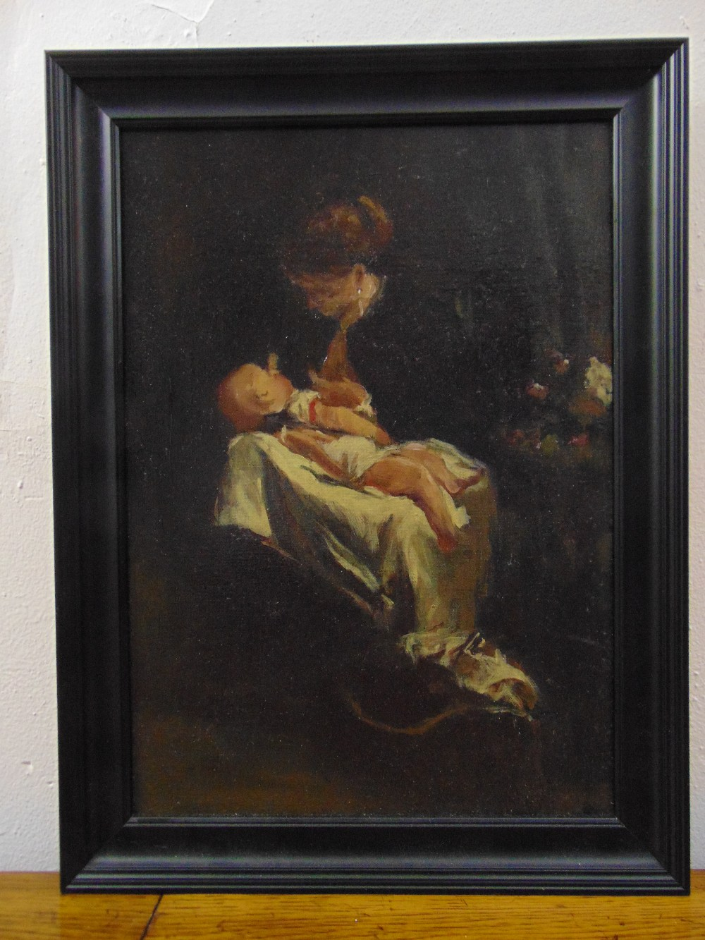 Lot 94 - A framed oil on panel of a mother and child, 41 x 29cm