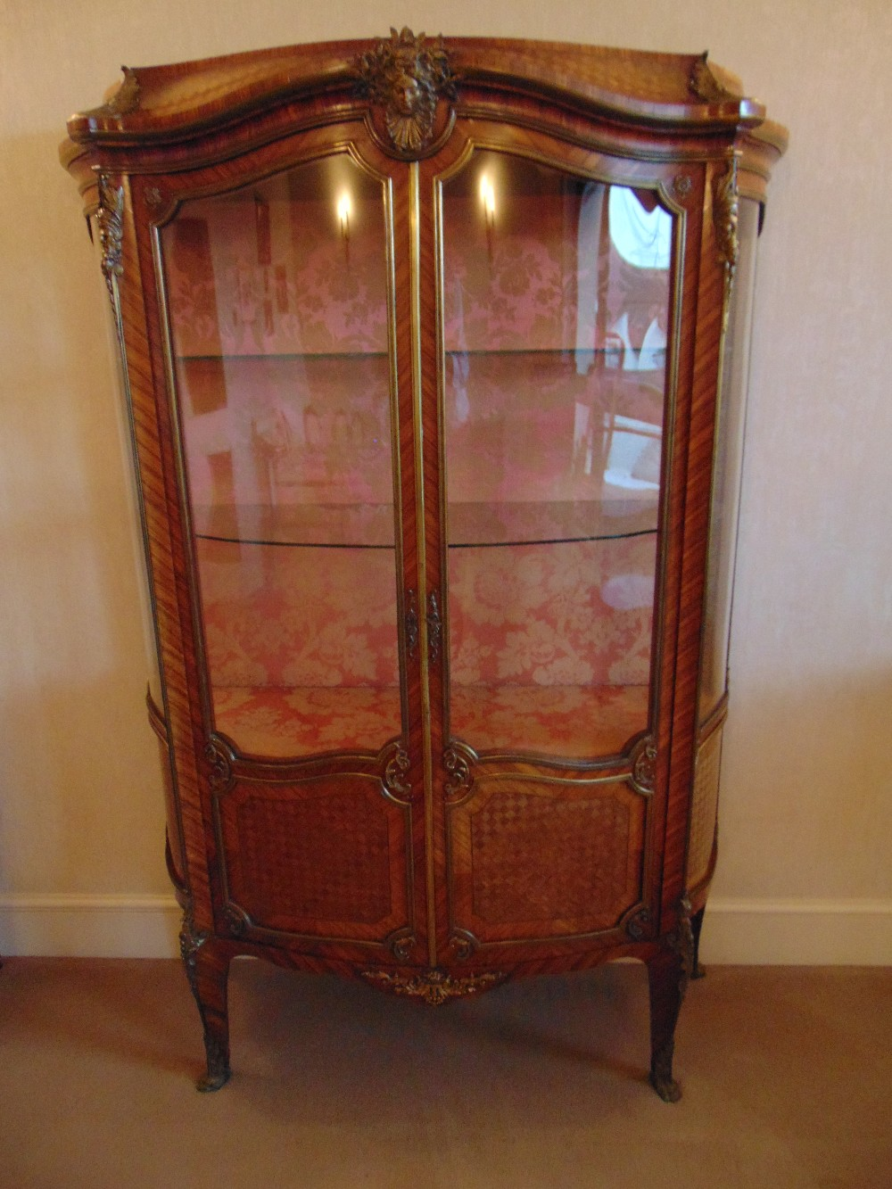 Lot 7 - A French style two door glazed Kingswood display cabinet with applied gilded metal mounts