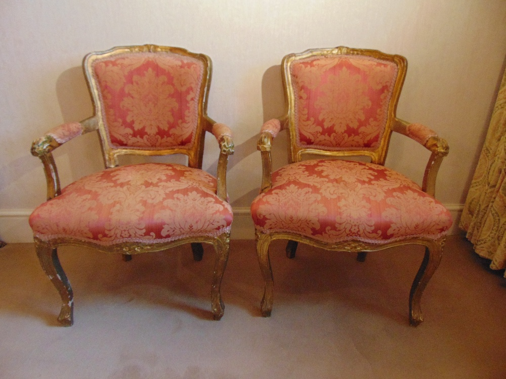 Lot 26 - A pair of French upholstered bedroom armchairs on cabriole legs