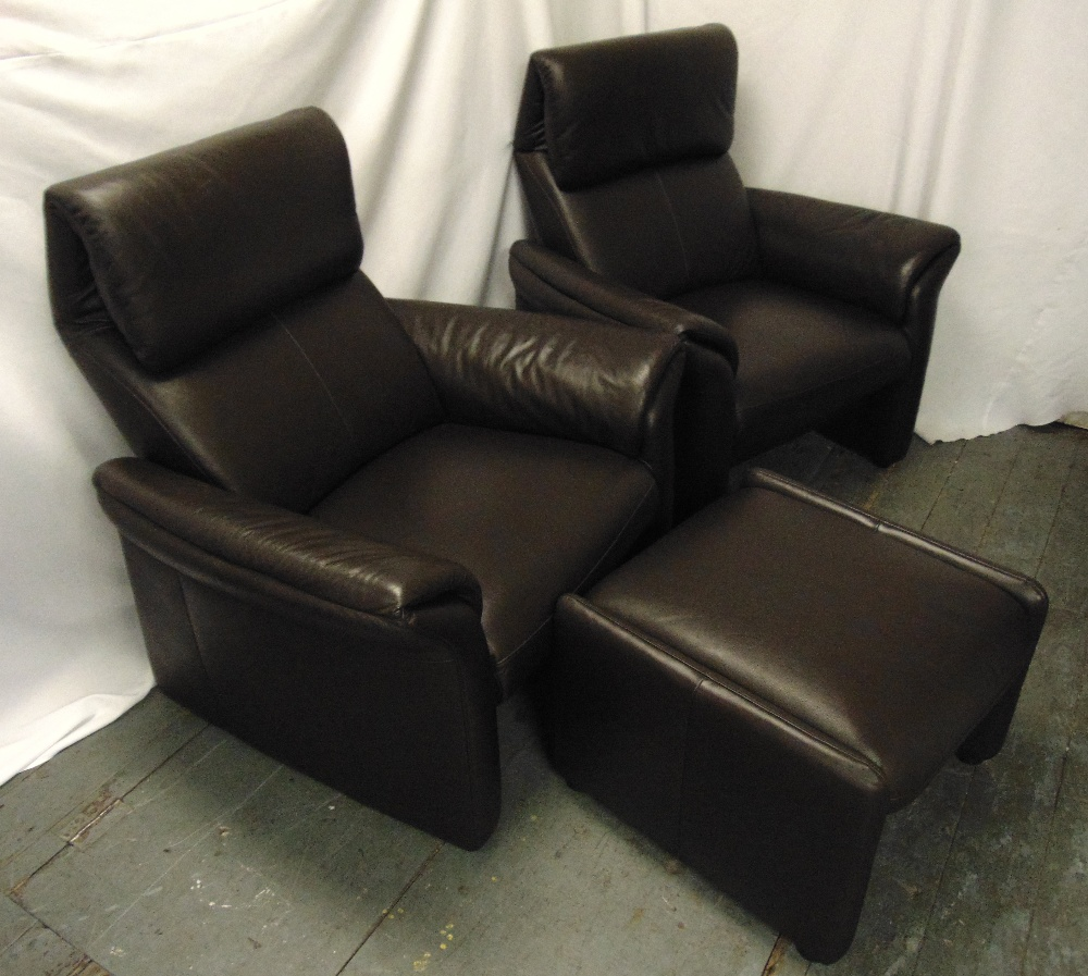 Lot 30 - A pair of leather armchairs and a matching foot stool
