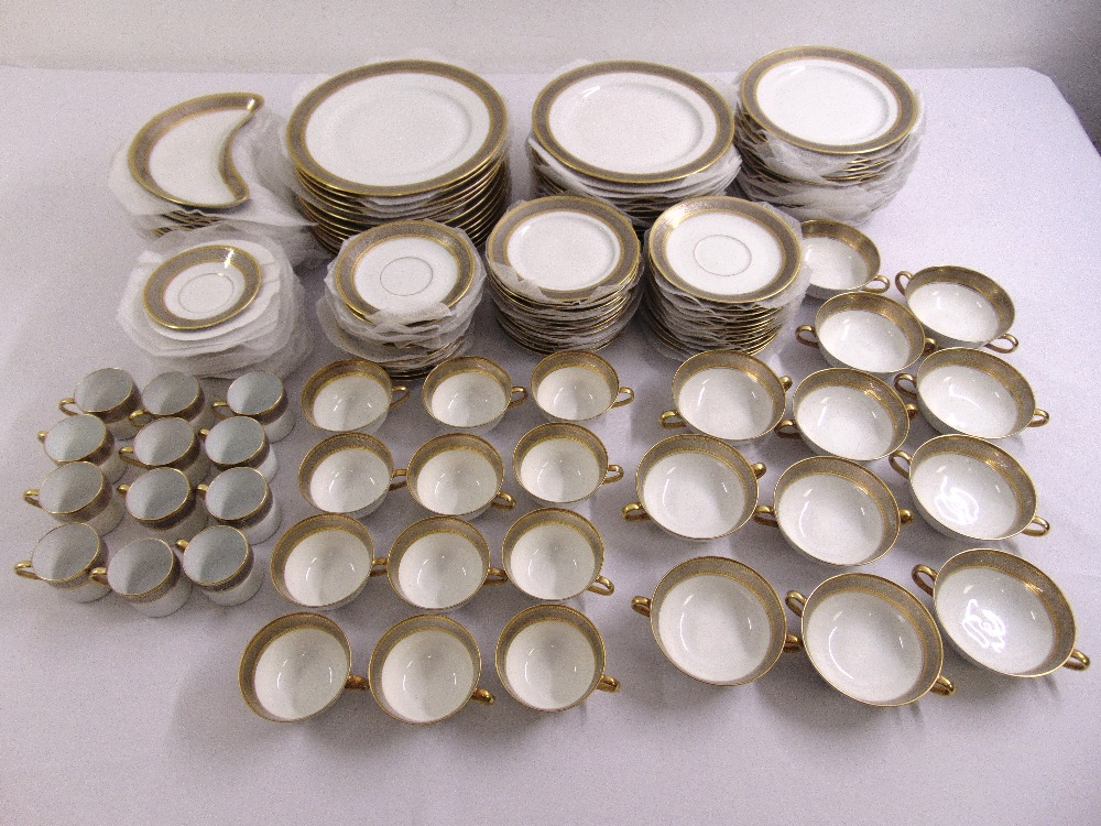 Lot 101 - Bernardaud Limoges dinner service cream and gilt to include plates, soup bowls, coffee cans and