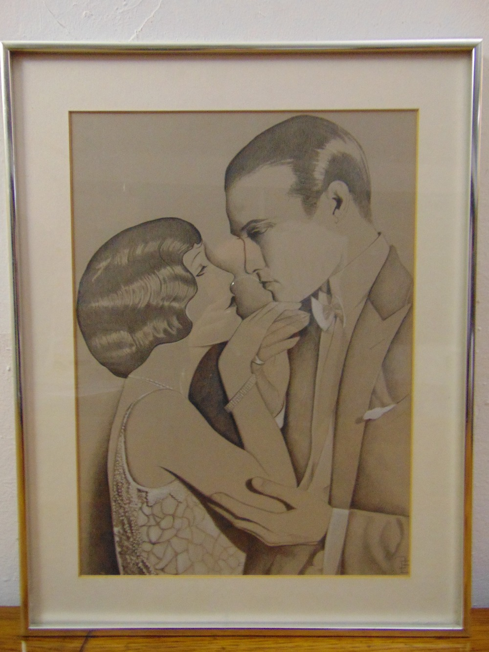 Lot 80 - A framed and glazed monochromatic drawing of a romantic couple, monogrammed bottom right, 42 x 30cm
