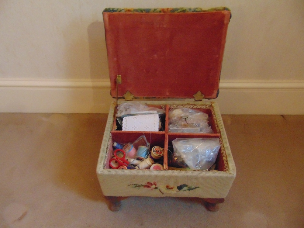 Lot 31 - A Victorian upholstered foot stool cum sewing box with accessories on four scroll feet