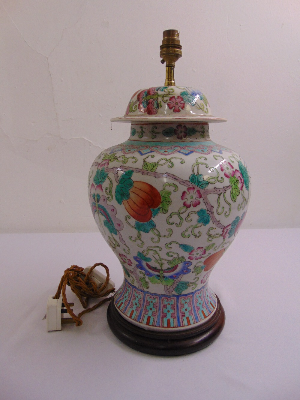 Lot 45 - A Chinese porcelain baluster vase decorated with flowers and butterflies, later converted to a table