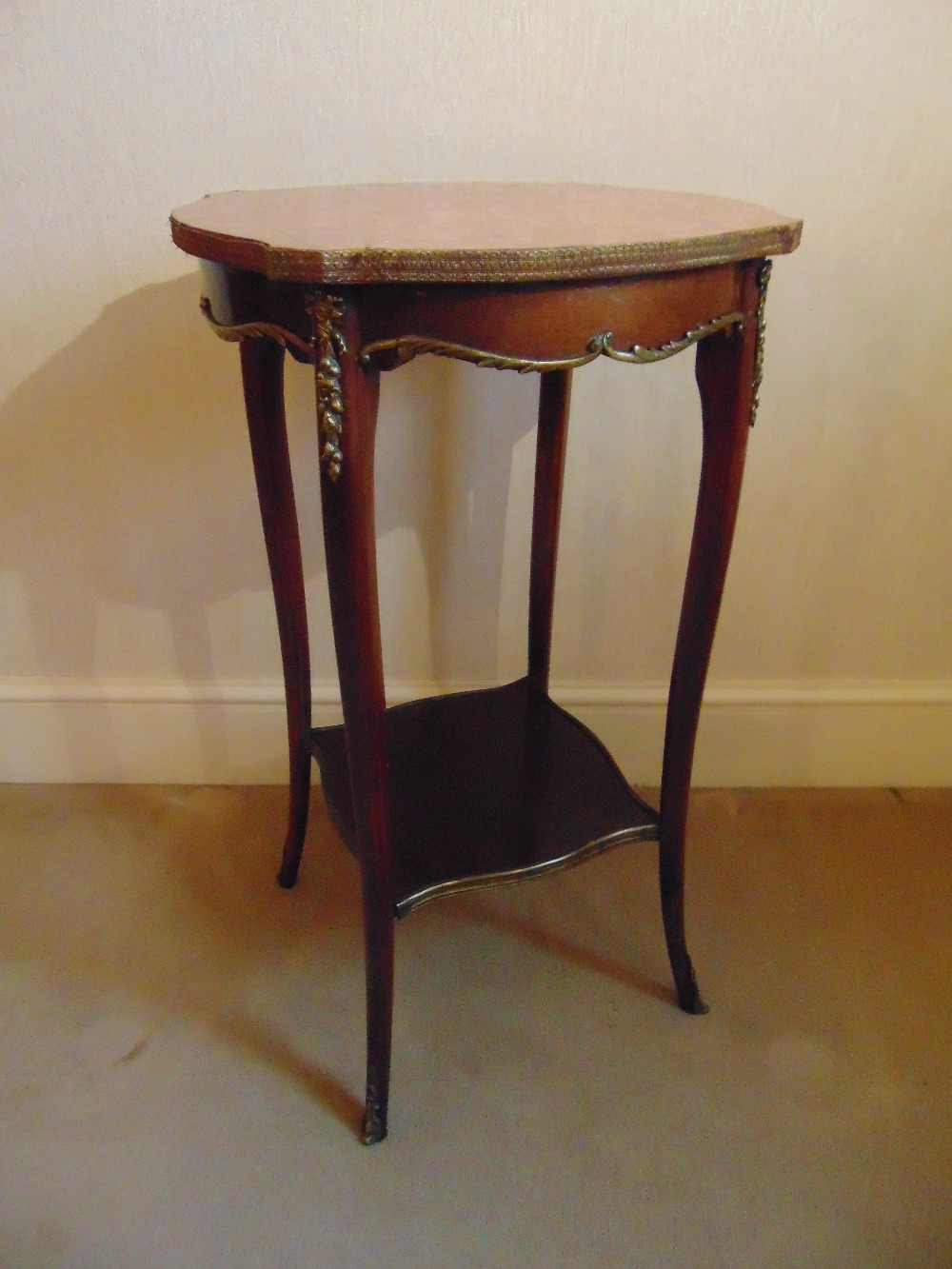 Lot 14 - A mahogany side table of shaped rectangular form with marble top and cabriole legs