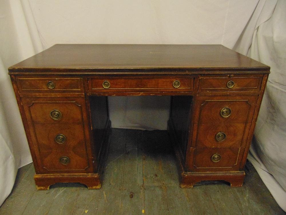 Lot 4 - An early 20th century rectangular mahogany partners desk with brass swing handles on bracket feet,