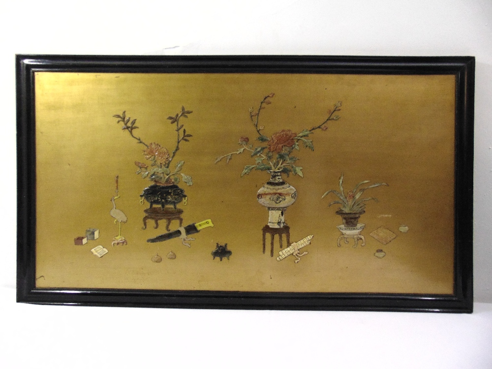 Lot 100 - An oriental rectangular lacquered wall panel set with vases and naturalistic forms of semi