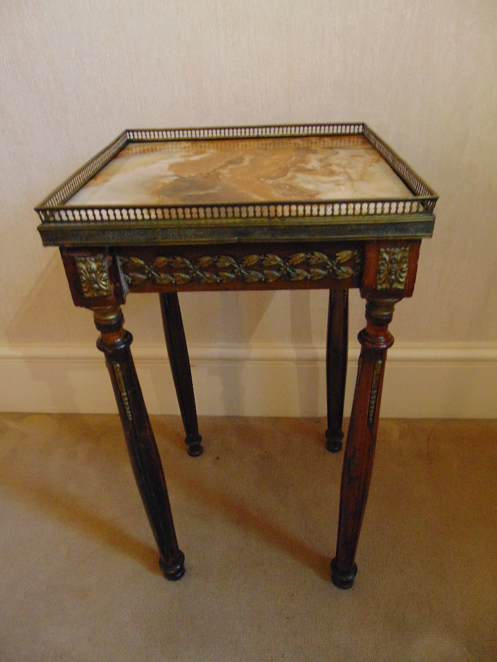 Lot 15 - A square gilded metal and marble side table with galleried top