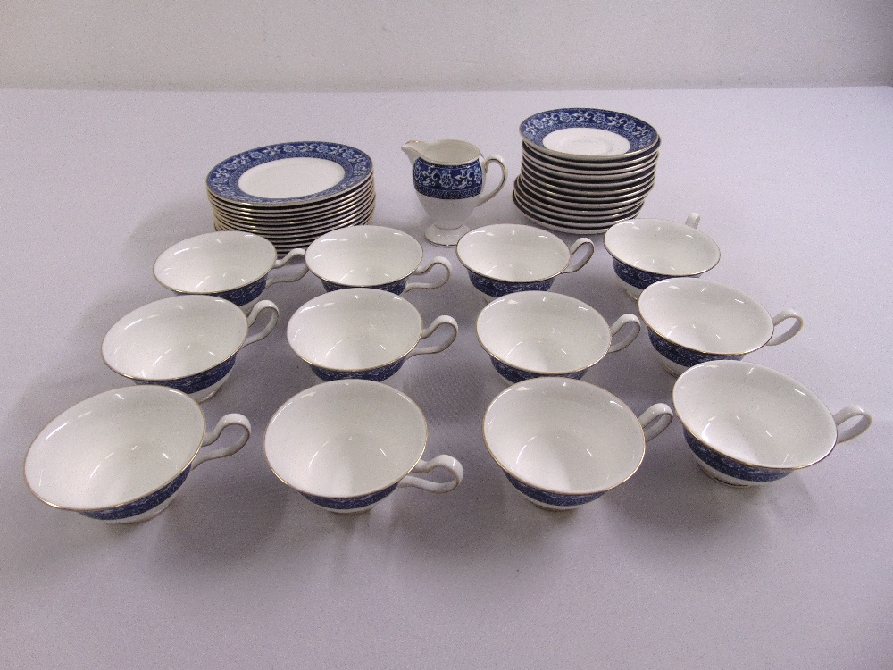 Lot 104 - Wedgwood part tea set in blue and white to include cups, saucers, a sandwich plate and a cream
