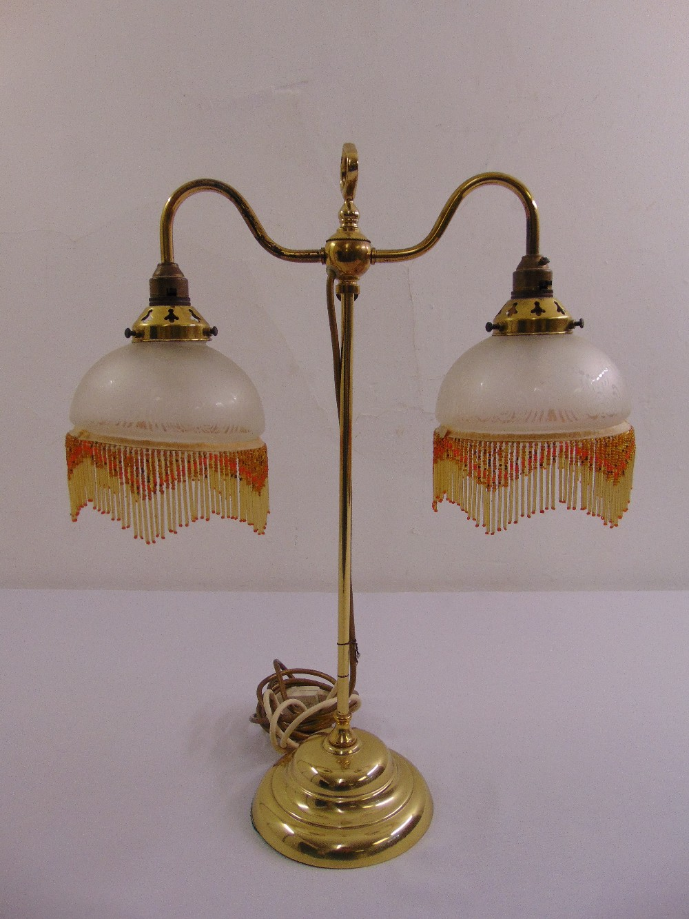 Lot 43 - A brass two branch Victorian style table lamp on raised circular base