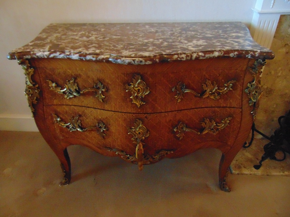 Lot 6 - A French Louis XVI style commode of shaped rectangular form with two drawers and marble top