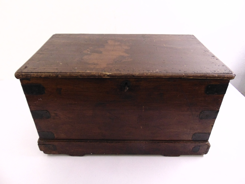 Lot 18 - An early 19th century rectangular mahogany chest with metal mounts and brass handles