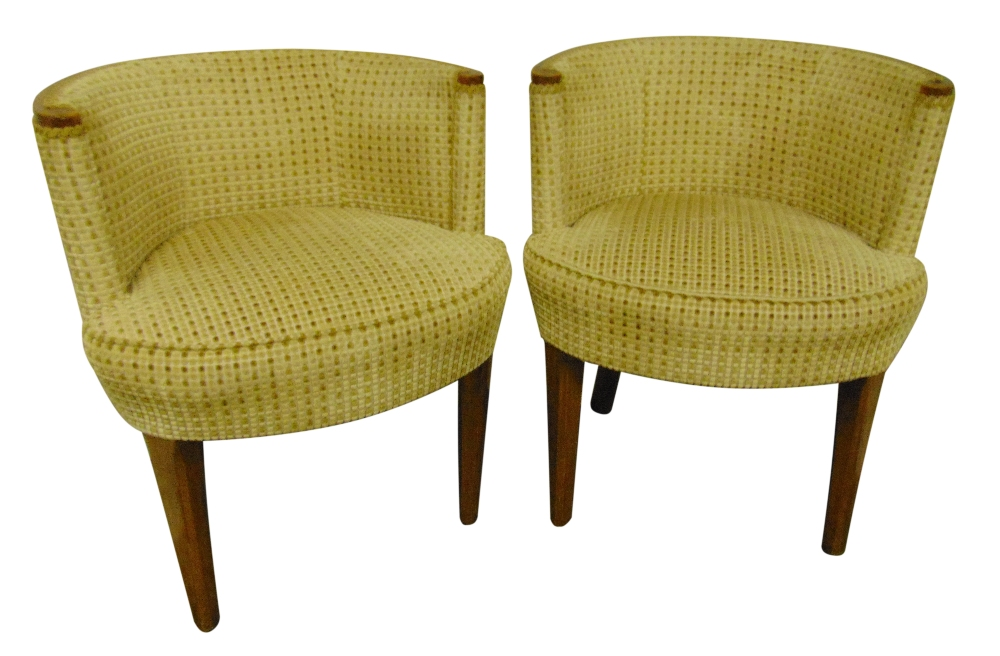 Lot 34 - A pair of Art Deco tub chairs with upholstered seats and backs on four tapering cylindrical legs