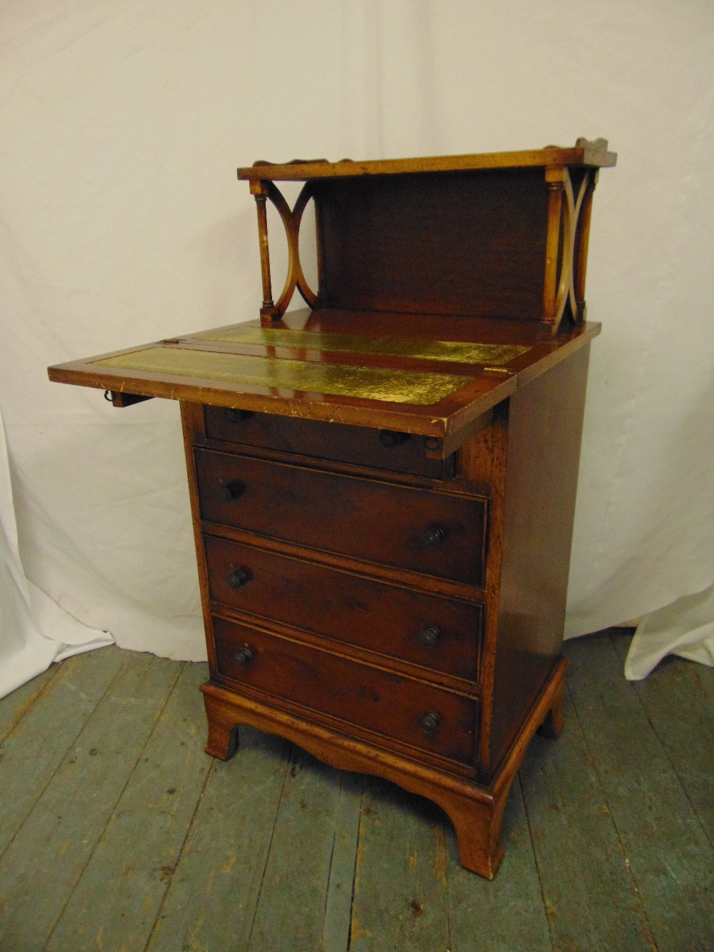 Lot 1 - An Edwardian rectangular desk with four drawers, hinged front and gallery shelf