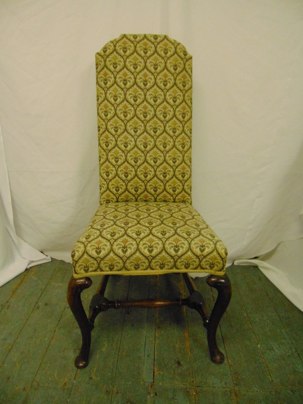 Lot 31 - A high back upholstered occasional chair on cabriole legs