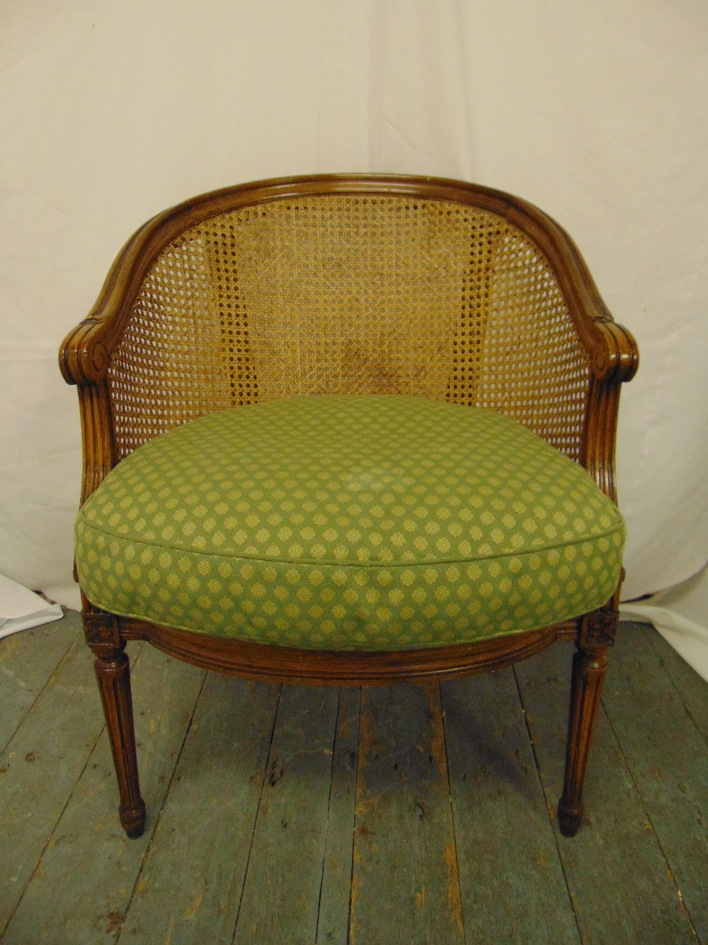 Lot 32 - A Victorian occasional chair with bergere cane and upholstered seat on fluted tapering cylindrical