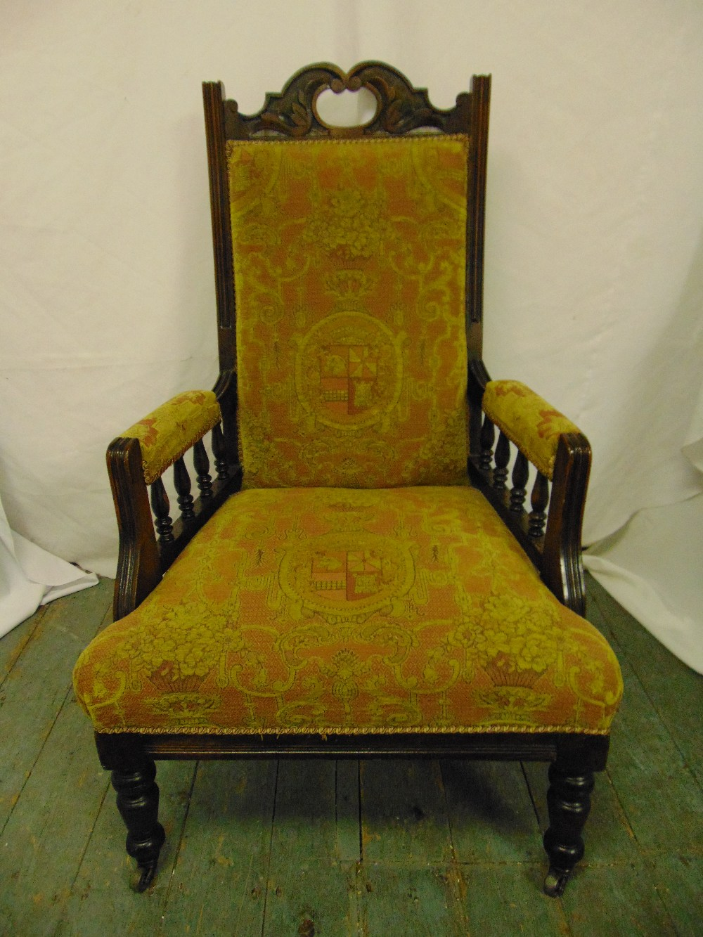 Lot 29 - An Edwardian mahogany upholstered armchair, galleried arms on four tuned cylindrical legs